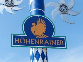 Höhenrainer-Delkatessen-Putenwurst-Firma-Maibaum-Logo